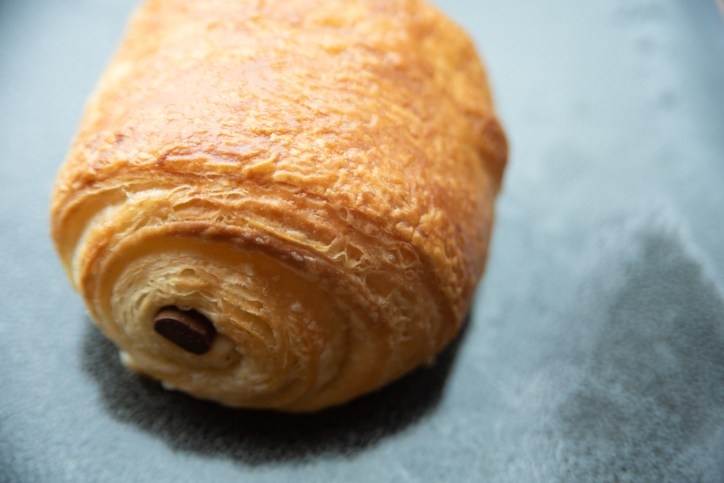 A chocolate croissant on a plate