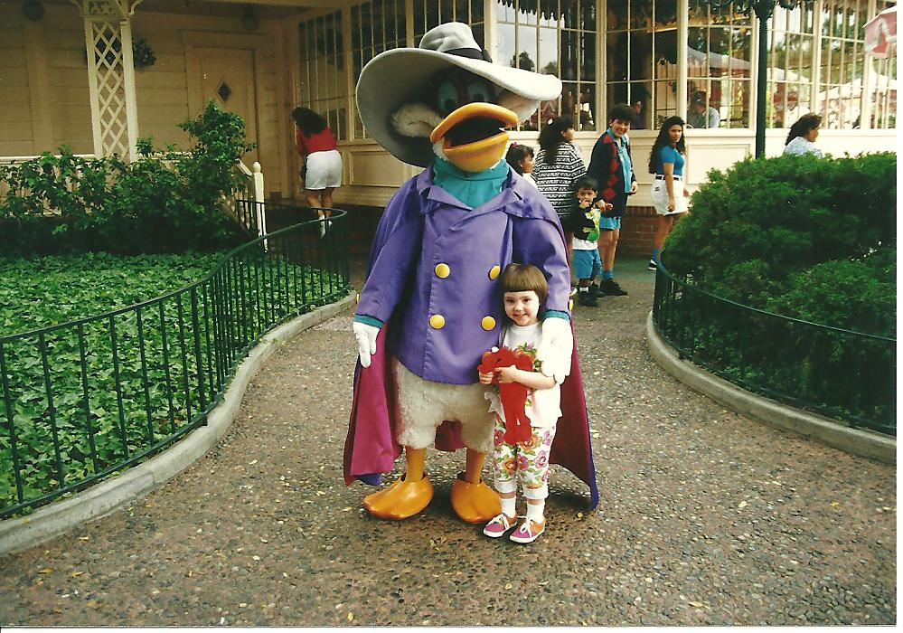 Alright, how come I don't have a photo of myself at Disneyland with Darkwing? BECAUSE THEY RETIRED THAT COSTUME IN 1992? WHAT? How could Disney betray me like this?