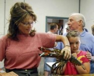 Sarah picks up a lobster at Yankee Seafood Cooperative in Seabrook NH - Palin and Sarahs Dad in photo also