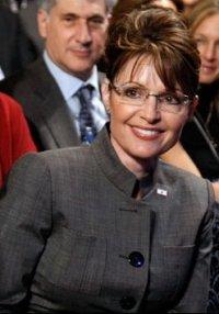 Sarah Smiling in Gray Jacket
