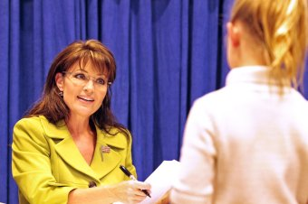 Sarah talking with young girl at book signing in New Orleans