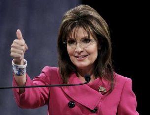 Sarah thumbs up in fuchsia jacket