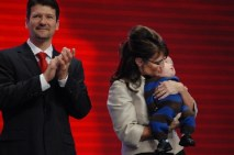 Todd clapping and Sarah holding Trig at RNC