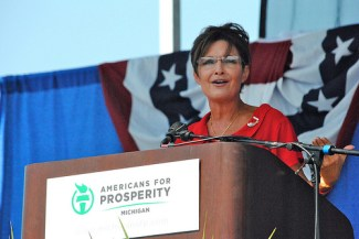 Closeup of Sarah at podium at Tea Party event in Michigan