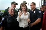Sarah gives thumbs up as she poses with security officers at Iowa Tea Party rally 2011