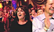 Sarah and Todd laughing in audience at DWTS All Stars