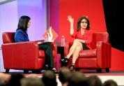 Sarah raises hand during question-answer session with Christina Gard at SEU leadership forum