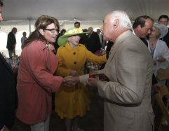 Sarah shakes hands with Ron Saykayl at annual fundraiser at Headley-Whitney Museum in Lexington KY May 5 2013
