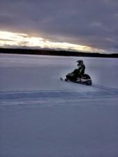 Tripp rides his snow machine