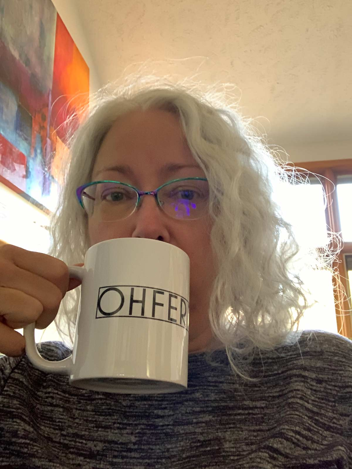 sarah drinking from a coffee mug