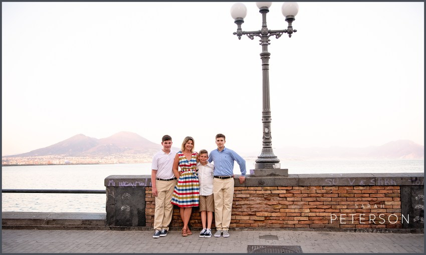 Mother with sons in front of mount Vesuvius at sunset Naples Italy