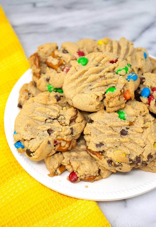 Loaded Peanut Butter Pretzel Cookies - soft, super duper peanut butter cookies loaded with crunchy pretzel pieces, mini chocolate chips and colorful mini M&M's candies; a scrumptious sweet and salty cookie delight.
