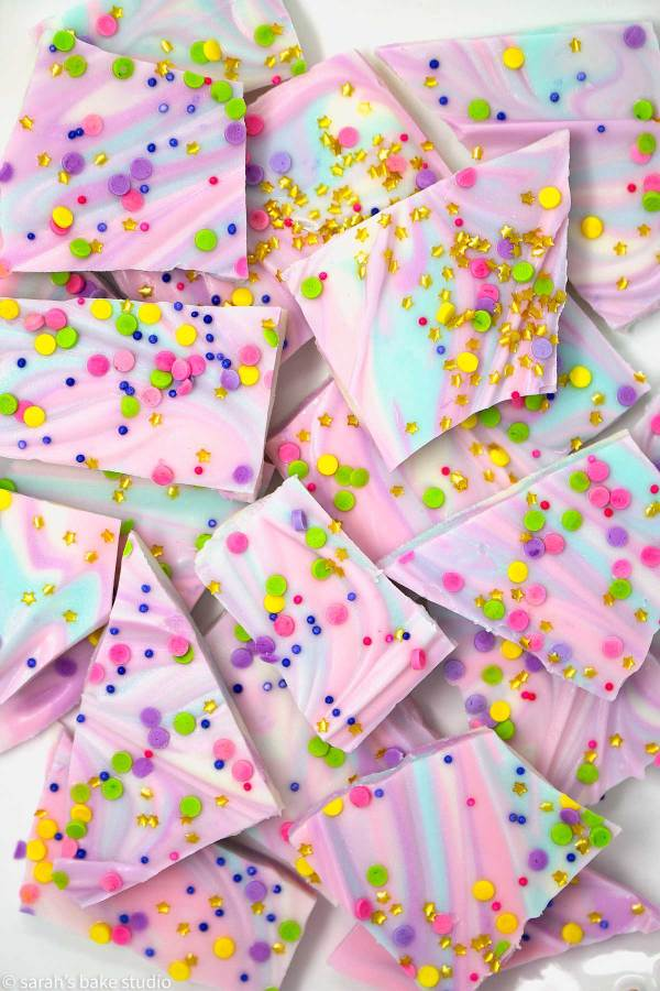 White Chocolate Unicorn Bark – colorful, melted white chocolate swirled together and topped with copious amounts of sprinkles make this unicorn inspired white chocolate magnificent fun and magically delicious.