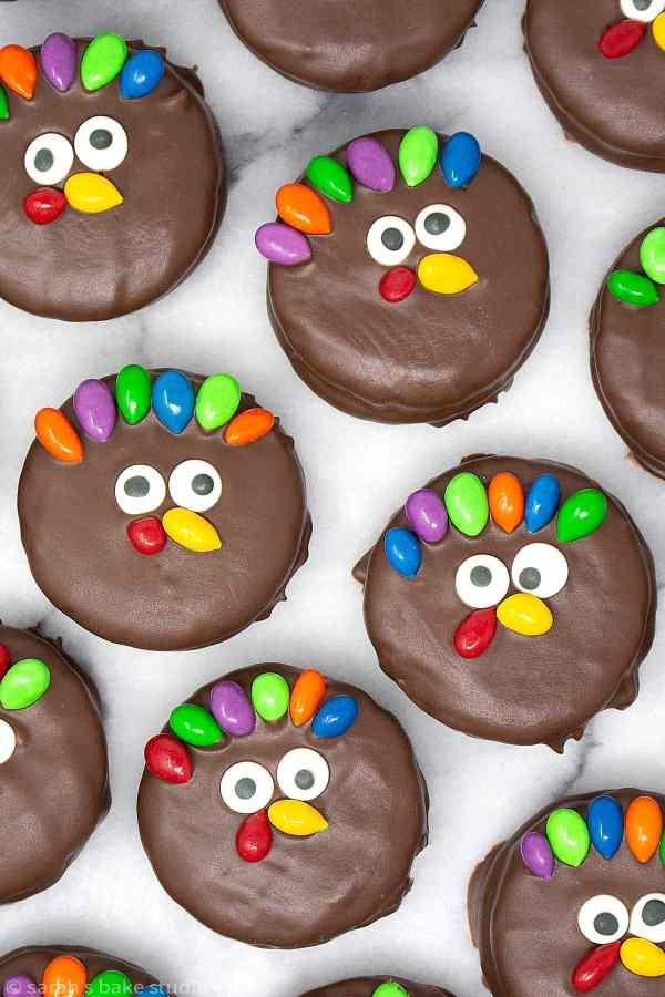 Turkey Nutter Butter Cookies - round peanut butter sandwich cookies bathed in melted chocolate and dressed up as turkeys with Sunburst Chocolate Covered Sunflower Seeds; a delightful Thanksgiving dessert.