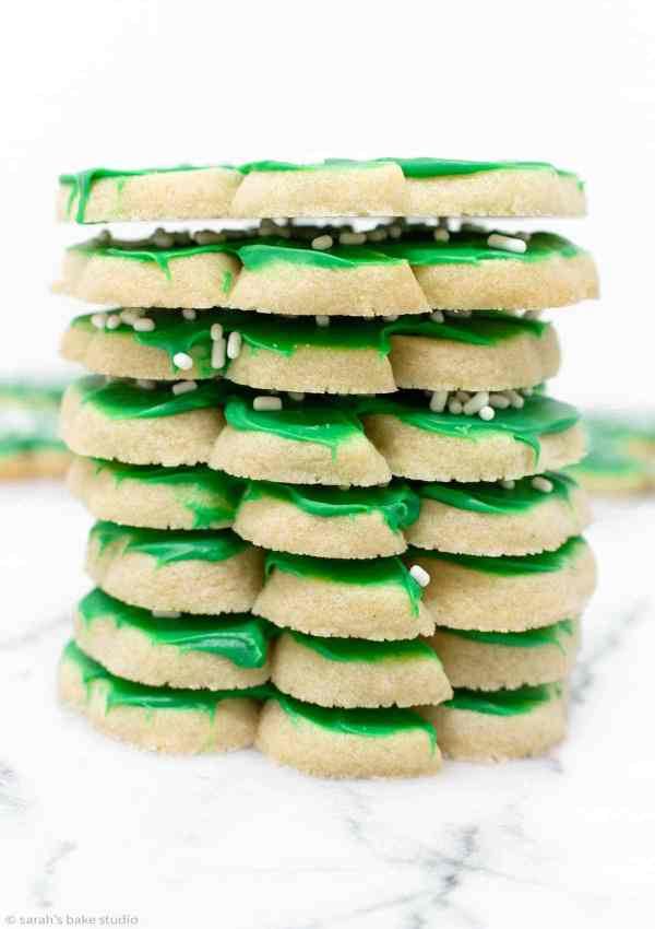 Shamrock Cookies - magically delicious shamrock sugar cookies frosted with melted green chocolate and topped with lucky white sprinkles for VERY St. Patrick's Day cookies.