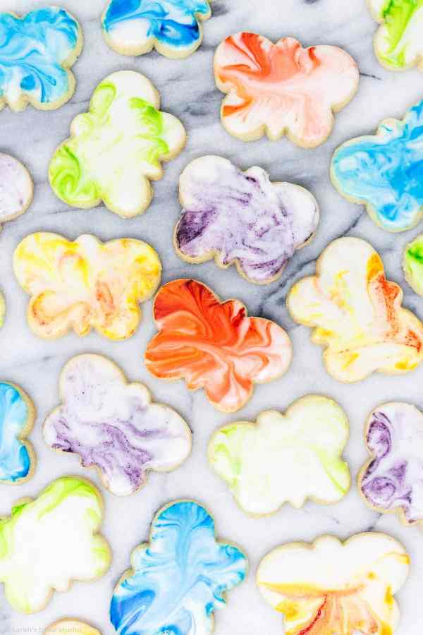 Marbled Butterfly Sugar Cookies - your favorite sugar cookies cut into butterfly shapes and frosted with marbleized royal icing; perfect spring Mother's Day cookies.