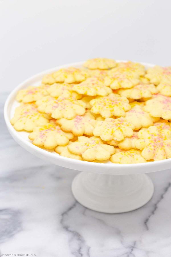 Lemon Spritz Cookies - soft and buttery, deliciously lemony, fun flowery cookie press spritz cookies.
