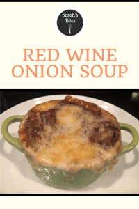 "Red wine onion soup in a soup crock with melted cheese on top. Image says ""red wine onion soup"" above the soup."