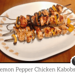 Chicken kabobs with peppers and onions on a platter