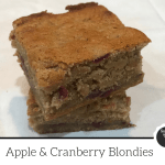 Two apple and cranberry blondies stacked