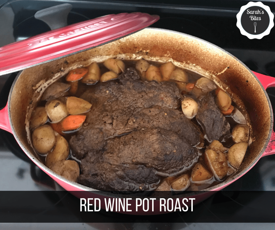 Pot roast in a dutch oven with potatoes and carrots