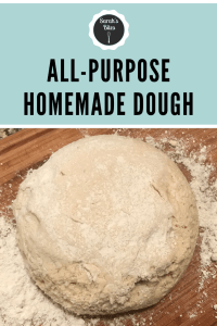 All purpose homemade dough on a wooden cutting board with flour