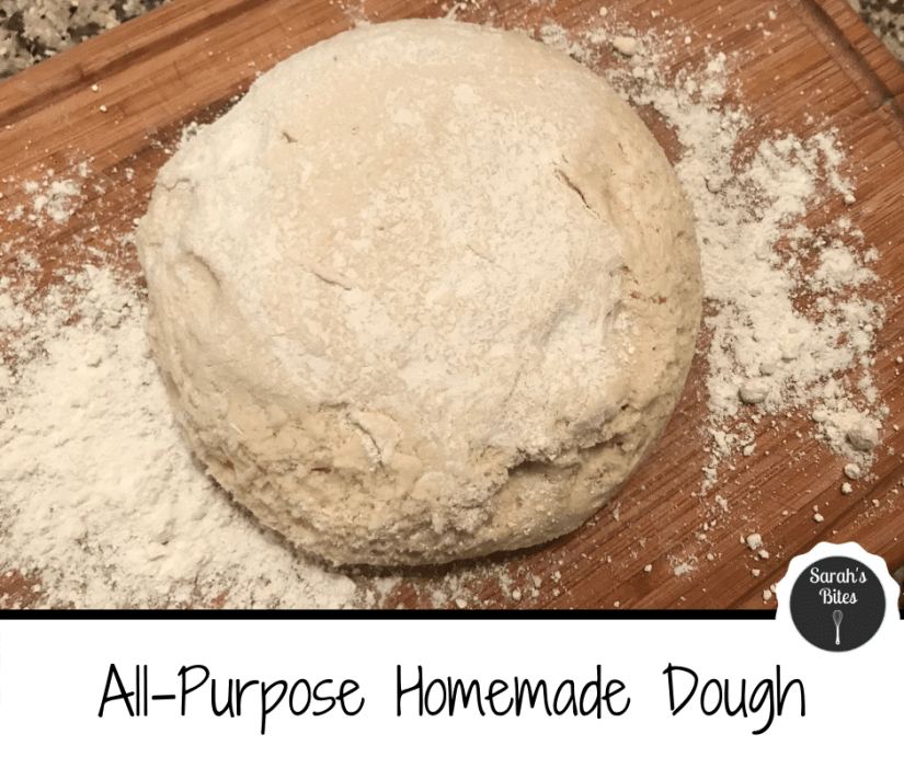 Dough on a wooden cutting board with flour