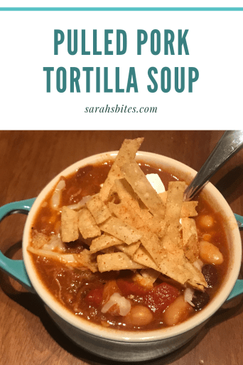 Single soup crock serving - soup with tomatoes, pulled pork, black beans, and great northern beans. Topped with grated cheese, sour cream, and tortilla strips.