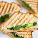 Panini sandwiches with chicken, avocado, and lettuce