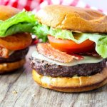 Cheeseburgers with bacon, tomato, and lettuce