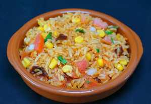 Rice with corn and tomatoes