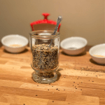 Seasoning in a jar with a spoon