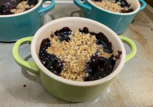 Blueberry mixture topped with a baked crumble in a ramekin