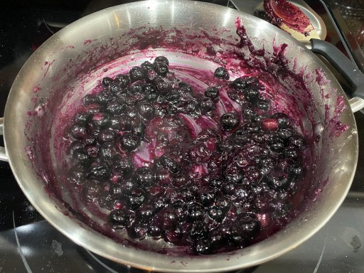 Gooey blueberry mixture cooking in a saute pan