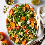 Salad with arugula and persimmons.