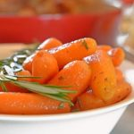 Cooked baby carrots with rosemary.