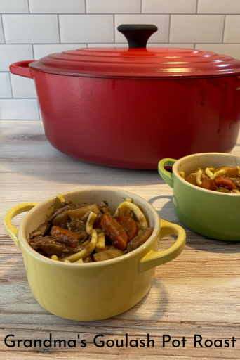 Two crocks of pot roast - beef with potatoes and carrots - served over spaetzle dumplings in front of a large dutch oven. Text over the image says Grandma's Goulash Pot Roast.