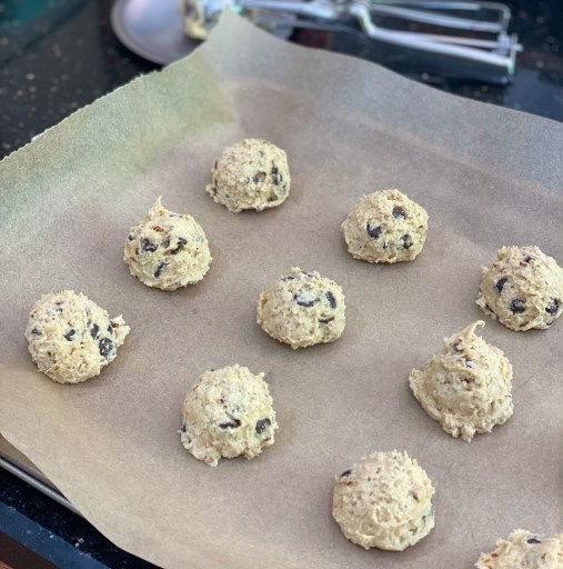 Raw cookies on a baking sheet.