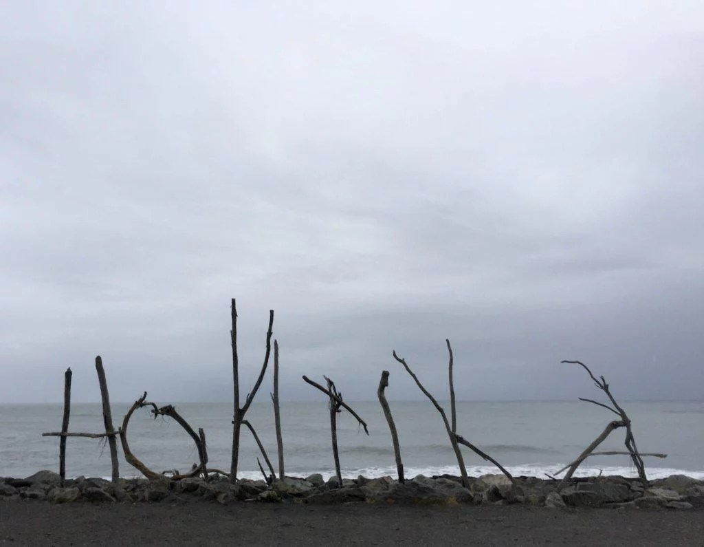 Hokitika Beach driftwood sign