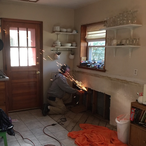 Kitchen sink pipe burst sparks