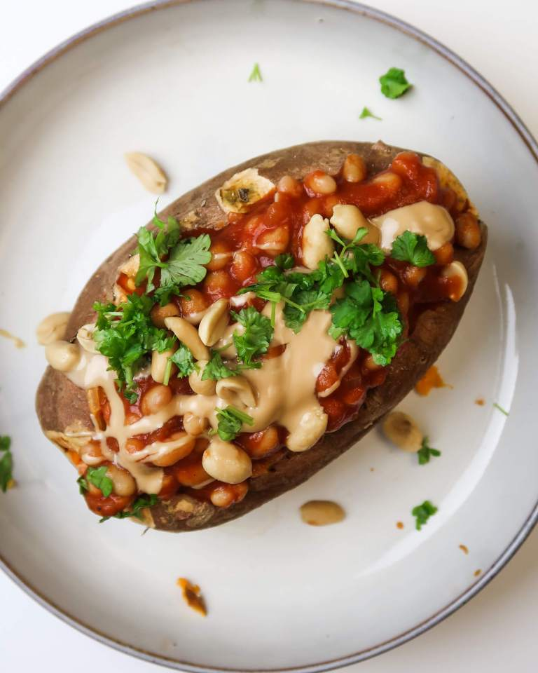 vegan stuffed sweet potato with white beans