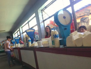 Dairy products in the market. Fresh butter, cheese, and sour cream.