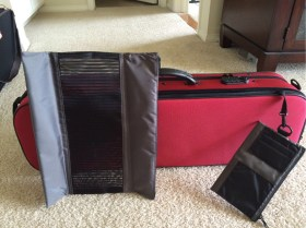 The music pocket (with removable inner pouches!) is on the bottom of the case: no more top-heaviness!