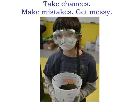"""Take chances. Make mistakes. Get messy"" and a photo of a boy in a science mask wearing gloves and holding a bucket of mud"