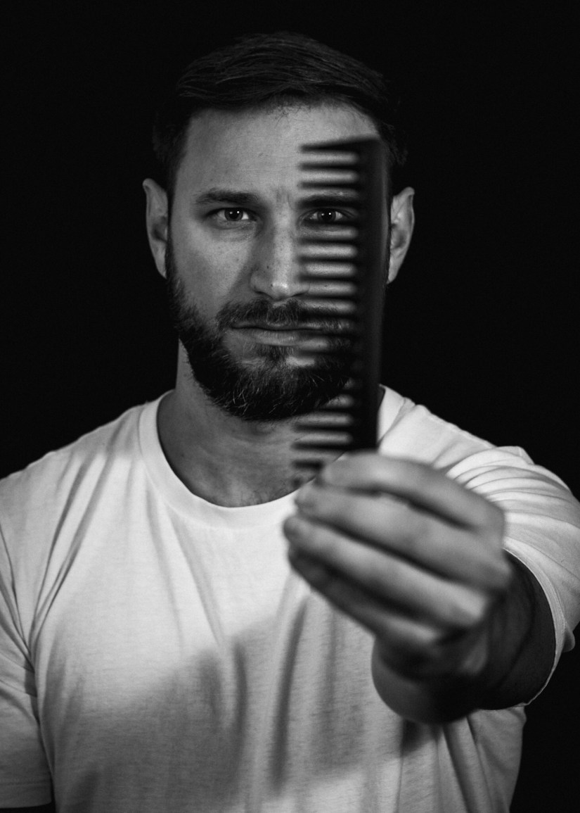 Hairdresser holding a comb