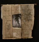 """""""There Was"""" - mixed media object by Sarah Zar. A black and white photograph of a man pulling a curtain open, framed in rustic wood."""