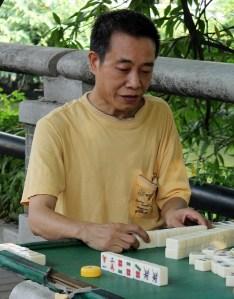 Man playing Mahjong