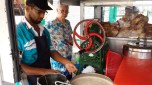 It's Ramadan, so no lines. He's shredding the ice block for our chendol.