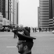 Republic of Chechnya, Russia, 03/2013. Security forces attending the celebration for the 10th anniversary of the Constitution Day. In the background Grozny City, five gleaming towers, the heart of the reconstruction of Grozny and a symbol of the city's recovery following the destruction wrought at the beginning of the millennium. Grozny, March 23rd 2013.