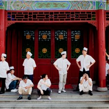 Members of the kitchen staff having a small break from work. West Lake Restaurant in Changsa, Hunan province, China. The biggest Chinese restaurant in the world.